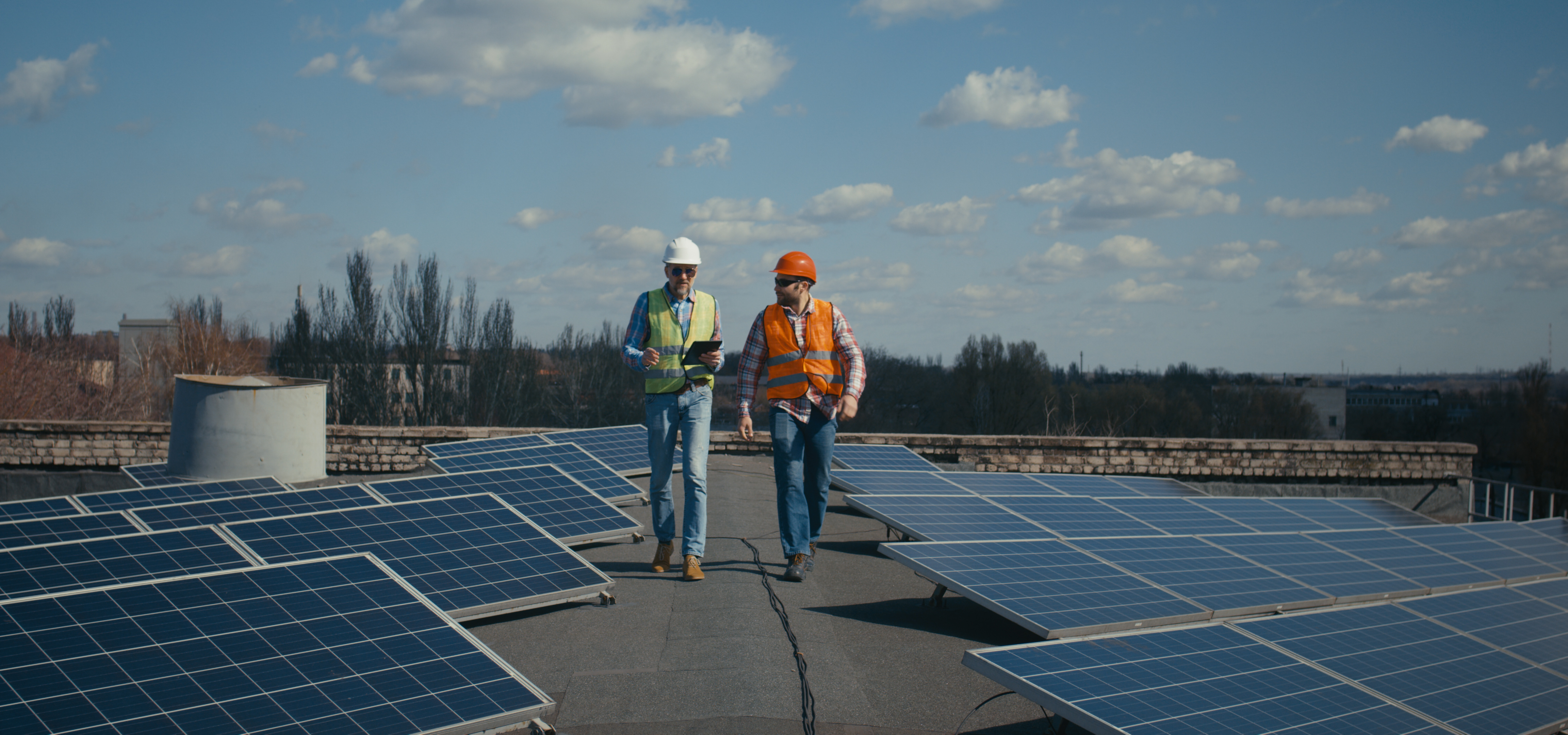 Flat Roof with Solar Panels being Surveyed by a Surveyor and Estimator